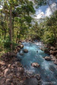 woman Rio Celeste blue river Costa Rica Central America